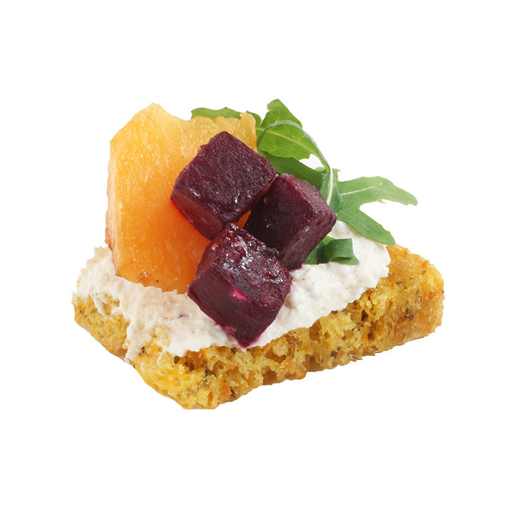 Carrot bread canapés with curd cream with caraway seeds, fried pumpkin and beetroot