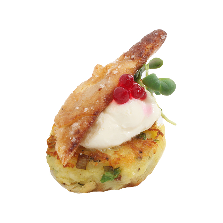 Potato cake with with capers, sour cream and crispy fried herring fillets