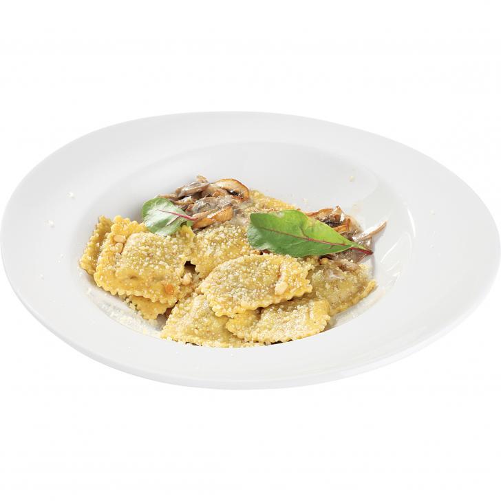 Bran ravioli stuffed with mushrooms, fried pine nuts, mushroom sauce and cheese