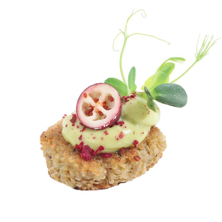 Quinoa cake with avocado cream and herbs