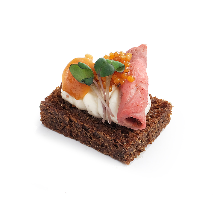 Rye bread canapes with roast beef, mustard cream, grain mustard, pickled mushrooms