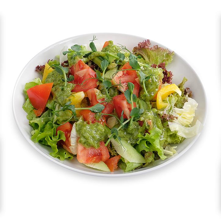 Fresh vegetable salad with green salad dressing