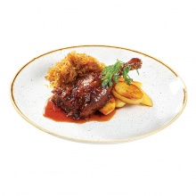 Duck leg, braised with apples, served with  honey potatoes and orange sauce