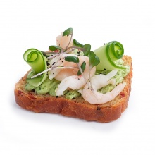 Beet bread slice with spinach cream cheese, shrimps and fresh cucumber