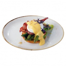 Brioche asparagus, poached egg, crispy bacon, avocado, tomato and Hollandaise sauce