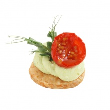 Cookie with green peas cream and grilled, pickled cherry tomato