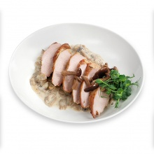 Pork fillet marinated in herbs with mushroom sauce