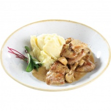 Pork fillet with mushrooms in creamy sauce with mashed potatoes