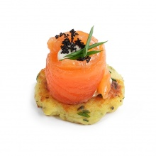 Potato and spring onion cake with salted salmon fillet and horseradish cream
