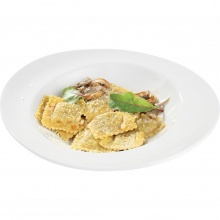 Bran ravioli stuffed with mushrooms, fried pine nuts, mushroom sauce and cheese