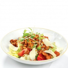 Ice salad with fried chanterelles, parmesan cheese and salmonberry sauce