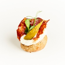 Mini jacket potato with horseradish cream, pickles and crunchy chorizo