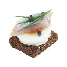 Rye canapes with mustard cream, eggs and salted herring fillet