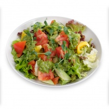 Fresh vegetable salad with green salad dressing
