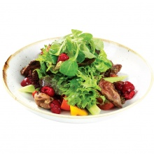 Fresh lettuce salad with chicken livers and raspberry sauce