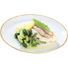 Pike perch fillet served with green pea and truffle puree, zucchini and spinach