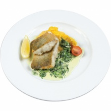 Pike perch fillet on a spinach bed with mashed potatoes and pumpkin